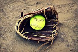 softball in glove